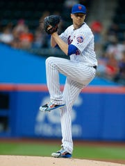 Jul 11, 2018; New York City, NY, USA; New York Mets starting pitcher Jacob deGrom (48) pitches against the Philadelphia Phillies in the first inning at Citi Field.