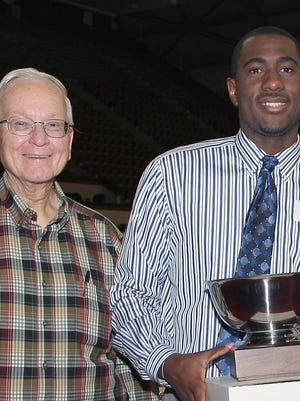 Abe Suydam presenting Jonathan Mitchell with the MVP award that bears his name in 2010.