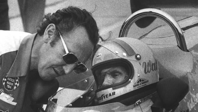 George Bignotti (left) leans in to talk with driver Wally Dallenbach before he qualifies the Sinmast/Goodyear Wildcat. Dallenbach earned the seventh starting spot and finished fourth in the race. Frank Fisse/The Star