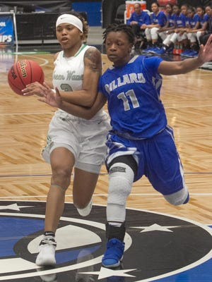 Fort Myers High School's Destanni Henderson drives towards the basket as Dillard High School's Kayla Burrows tries to defend during the second half of their FHSAA Girls 7-A Semifinal game at The RP Funding Center in Lakeland Friday. March 2, 2018. (SPECIAL TO THE NEWS PRESS/MICHAEL WILSON)