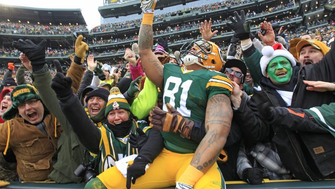 Green Bay Packers tight end Andrew Quarless (81) celebrates his first quarter touchdown against the Dallas Cowboys during an NFC divisional playoff  Sunday, January 11, 2015, at Lambeau Field in Green Bay, Wis.  Wm.Glasheen/P-C Media