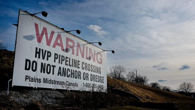 A sign warns boaters of a pipeline traveling under the St. Clair River Friday, Jan. 2, 2014 in Corunna, Ontario.