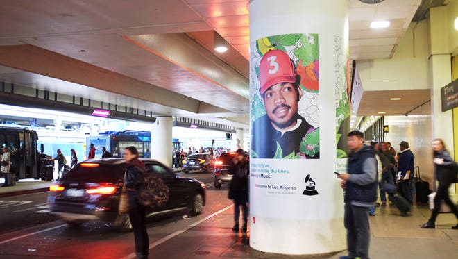 A photo of Chance the Rapper greets travelers at Los Angeles International Airport.