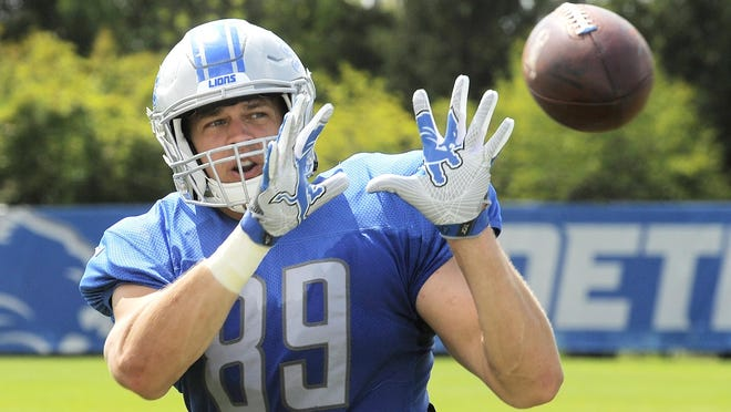 Lions tight end Cole Wick readies his hands for a reception from the passing machine at the end of Monday's practice in Allen Park.