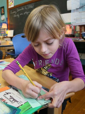 Howard Avenue Montessori first-grader Lola Zysckiewiez, 6, uses her ruler to draw a line.