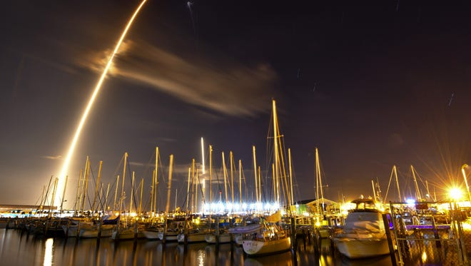 A SpaceX Falcon 9 rocket carrying the government's secret Zuma payload flew from Launch Complex 40 at Canaveral Air Force Station at 8 p.m. Sunday. The first stage of the rocket returned to the Cape Canaveral, successfully touching down at Landing Zone 1. Photograph is an 8-minute time exposure of the launch and landing in one photo taken from the Ocean Club Marina at Port Canaveral.