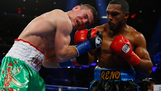 Tureano Johnson punches Eamonn O'Kane during their IBF middleweight title eliminator bout at Madison Square Garden Saturday (Photo by Al Bello/Getty Images)