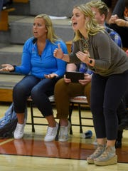 Lincoln's head volleyball coach Emily Palmer reacts to a ref's call against Washington at Washington High School on Oct. 18, 2016