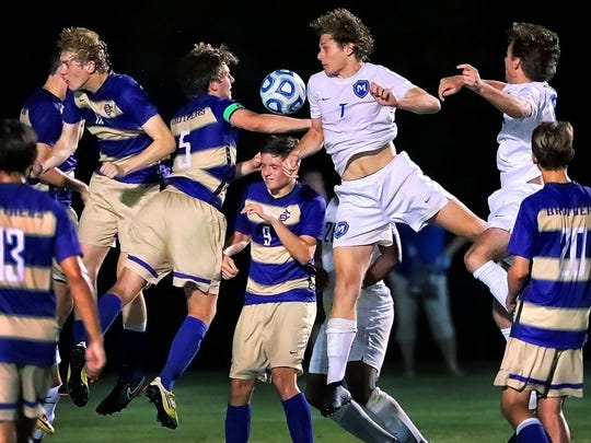 Christian Brothers and McCallie players go head to head for control of a penalty kick during their DII-AA state semifinals game at Spring Fling last year.
