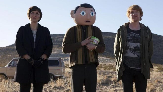 """Maggie Gyllenhaal, MIchael Fassbender and Domhnall Gleeson star in a scene from """"Frank."""""""