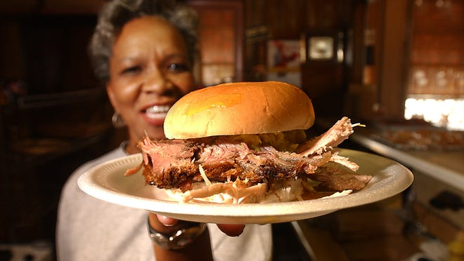 Flora Payne serves up another sliced pork barbecue sandwich at Payne's on Lamar.  (Dave Darnell/The Commercial Appeal files)