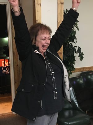 Pam Carter celebrates as she walks into her election night party after winning the Pastures District seat on the Augusta County Board of Supervisors Tuesday.