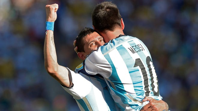 Argentina's Lionel Messi (right) celebrates with Angel di Maria after di Maria scored the winning goal in extra time in a World Cup round of 16 match against Switzerland at the Itaquerao Stadium in Sao Paulo, Brazil, on Tuesday. Argentina defeated Switzerland 1-0 to move on to the quarterfinals.
