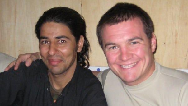 Janis Shinwari, left, with Army Capt. Matthew Zeller in 2008.