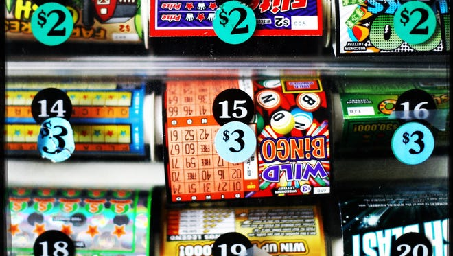 Lottery tickets are shown for sale in Stoughton, Wis. Wisconsin has no laws preventing retail lottery sellers or their employees or owners from buying and cashing in lottery tickets at their own stores — a gap in regulation that could open the state's lottery system to fraud.