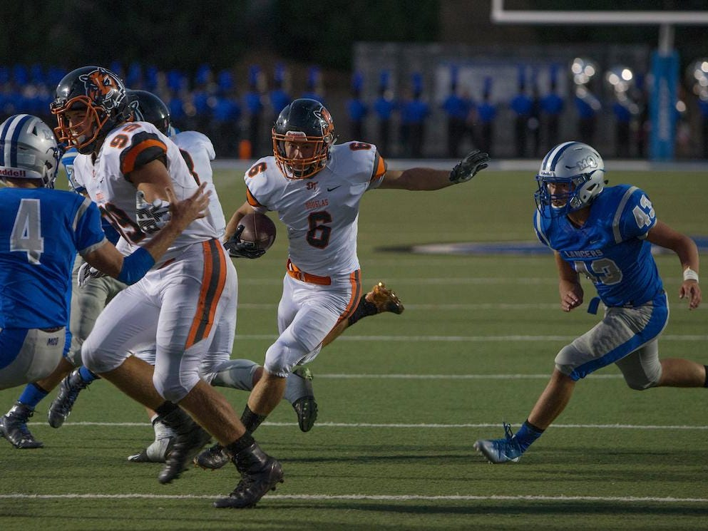 Douglas' Dawson Coman runs towards the end zone against McQueen on Friday.