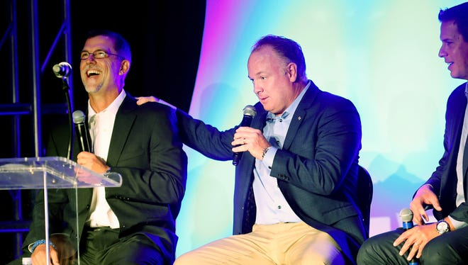 Kentucky's football's head coach Mark Stoops jokes around with offensive coordinator Eddie Gran at the 2016 Wildcat Football Kickoff Luncheon.