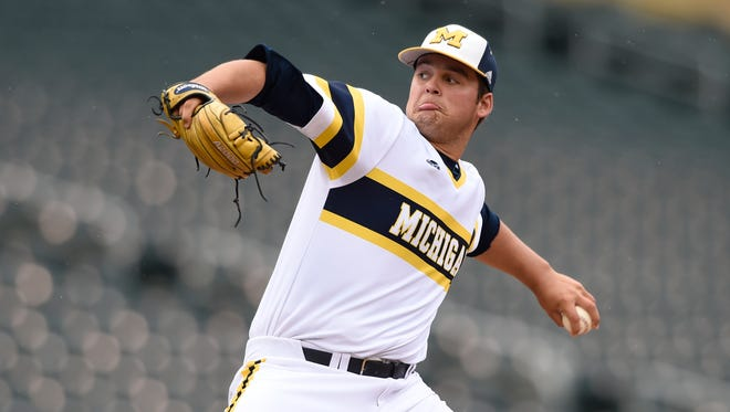 Michigan starting pitcher Brett Adcock delivers against Maryland on May 24, 2015, in Minneapolis.