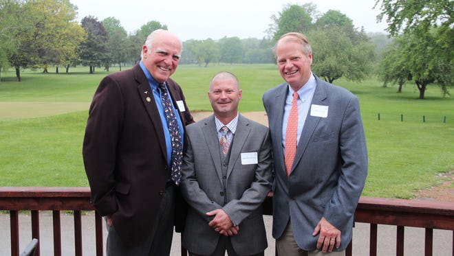 DNR conservation warden Mike Hirschboeck (center) was awarded the Haskell Noyes Efficiency Award as the state's top field warden for 2016. Haskell Noyes III of Mequon (left) and Chris Noyes of River Hills carry on the tradition of presenting the annual award started by their grandfather in 1930.