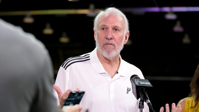 San Antonio Spurs head coach Gregg Popovich is interviewed during media day at the Spurs training facility.