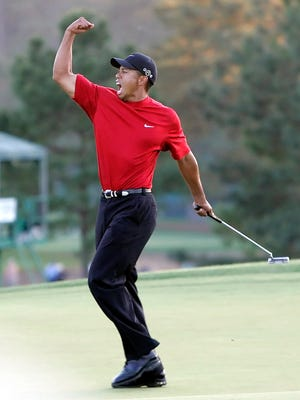 Tiger Woods celebrates winning the 2005 Masters in a playoff with Chris DiMarco at the Augusta National Golf Club in Augusta, Ga.