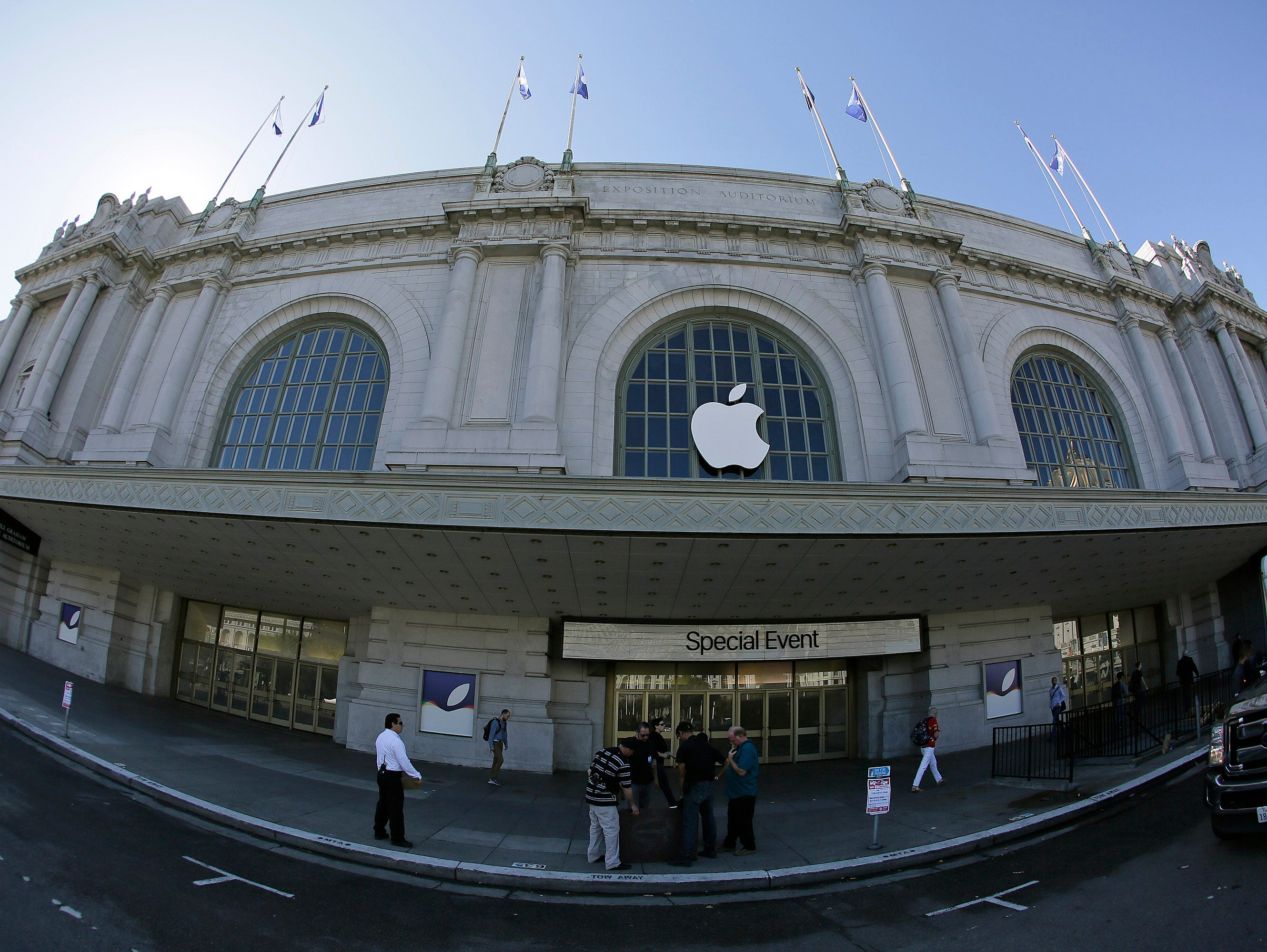 A crew works outside the Bill Graham Civic Auditorium as preparations continue for the Apple new product announcements in San Francisco. Along with new iPhones, the iconic tech company is expected to show off a new Apple TV system and a bigger role i