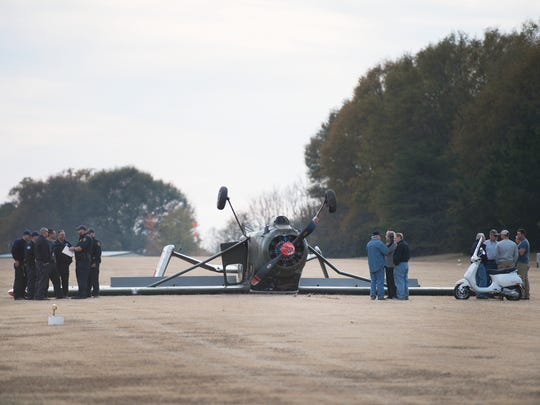 Bystanders and first responders on the scene where a French military MH-1521 plane flipped on a private airstrip in Simpsonville on Tuesday, November 22, 2016.
