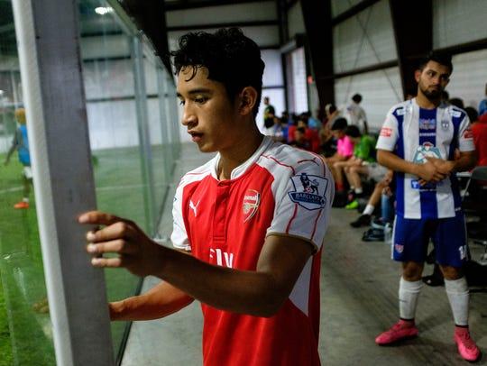 Carlos Pacheco, 18, of Berea High School, closes the