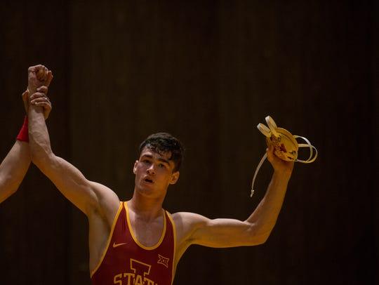 Iowa State's Jarrett Degen celebrates after beating