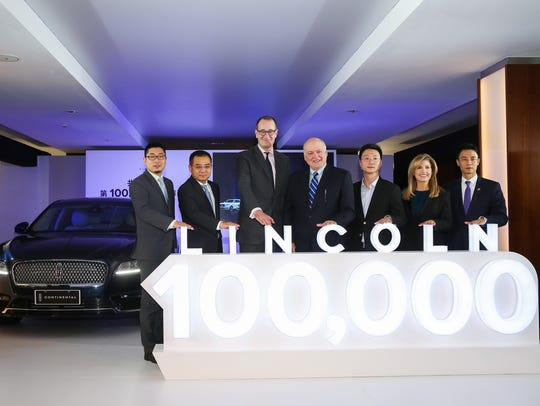 Frank Fan, vice president of Lincoln China; Jason Luo, chairman and chief executive officer, Ford China; Peter Fleet, group vice president and president, Ford Asia Pacific; Jim Hackett, president and CEO, Ford Motor Co.; Pan Yingjie, car owner; Amy Marentic, president, Lincoln China; Freddie Xu, president, Yongda Group, at the delivery of the 100,000th Lincoln vehicle in China this month.