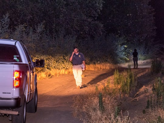 Detective John Nicholson, left, and Field Evidence Technician Miriam Gomez walk along the Kaweah River west of Road 212 in Woodlake on Tuesday, June 26, 2018. A 7-month-old fell from a raft in the river and went downstream, out of sight from the family. A friend of the family found the baby in the water on the other side of Road 212 but was also overcome by the river and had to be pulled from the water. Both are in critical condition.
