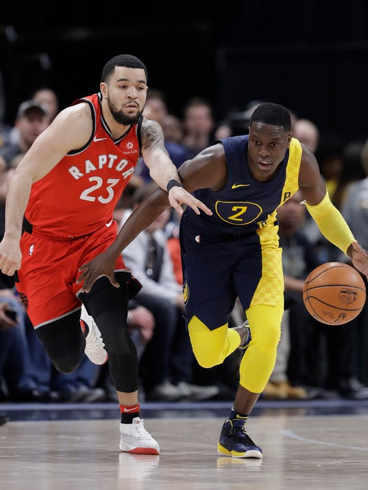 Indiana Pacers' Darren Collison is chased by Toronto Raptors' Fred VanVleet during the second half of an NBA basketball game Thursday, March 15, 2018, in Indianapolis. Toronto won 106-99. (AP Photo/Darron Cummings)