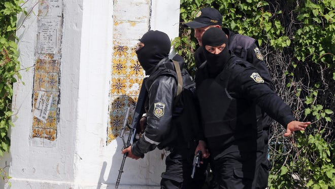 Members of the Tunisian security services take up a position outside the National Bardo Museum in Tunis, Tunisia after gunmen reportedly took hostages.