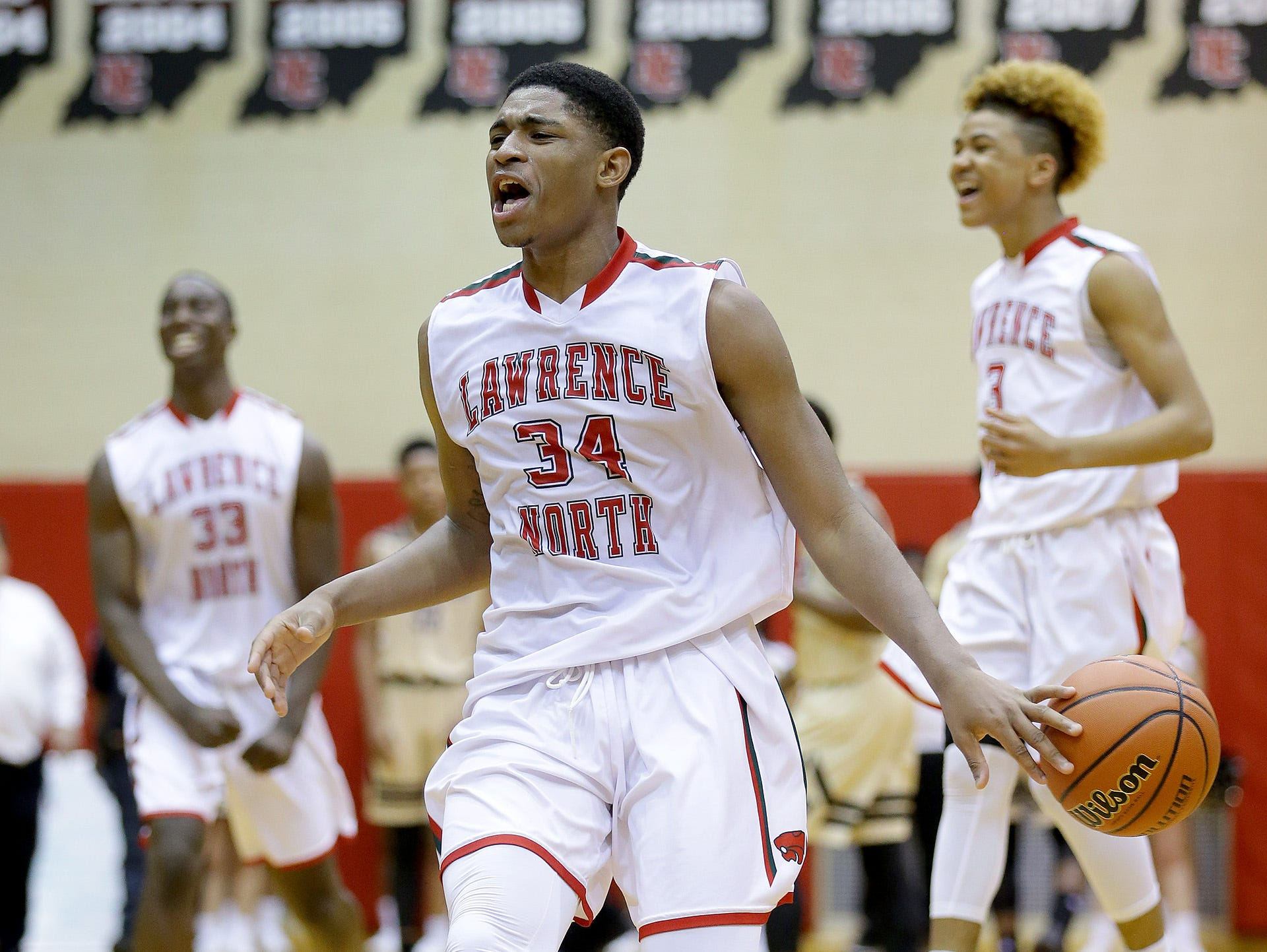 Lawrence North's Kevin Easley (34) begins to celebrate as time runs off the clock at the end of their win Tuesday over Warren Central.