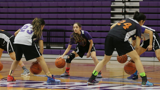 Eastlake's Daniela Gutierrez, center, and teammates go through drills Wednesday.