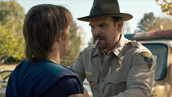"""Charlie Heaton, left, and David Harbour co-star in a scene from Netflix's """"Stranger Things."""""""