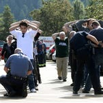Police search students outside Umpqua Community College.