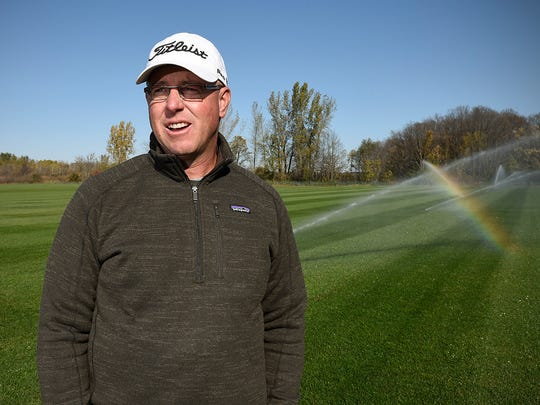 Brian Deyak, ProFields, talks about his new business Thursday, Oct. 13, at Pinecone Central Park in Sartell. Deyak's new turf management company has been working on a number of projects in the area.