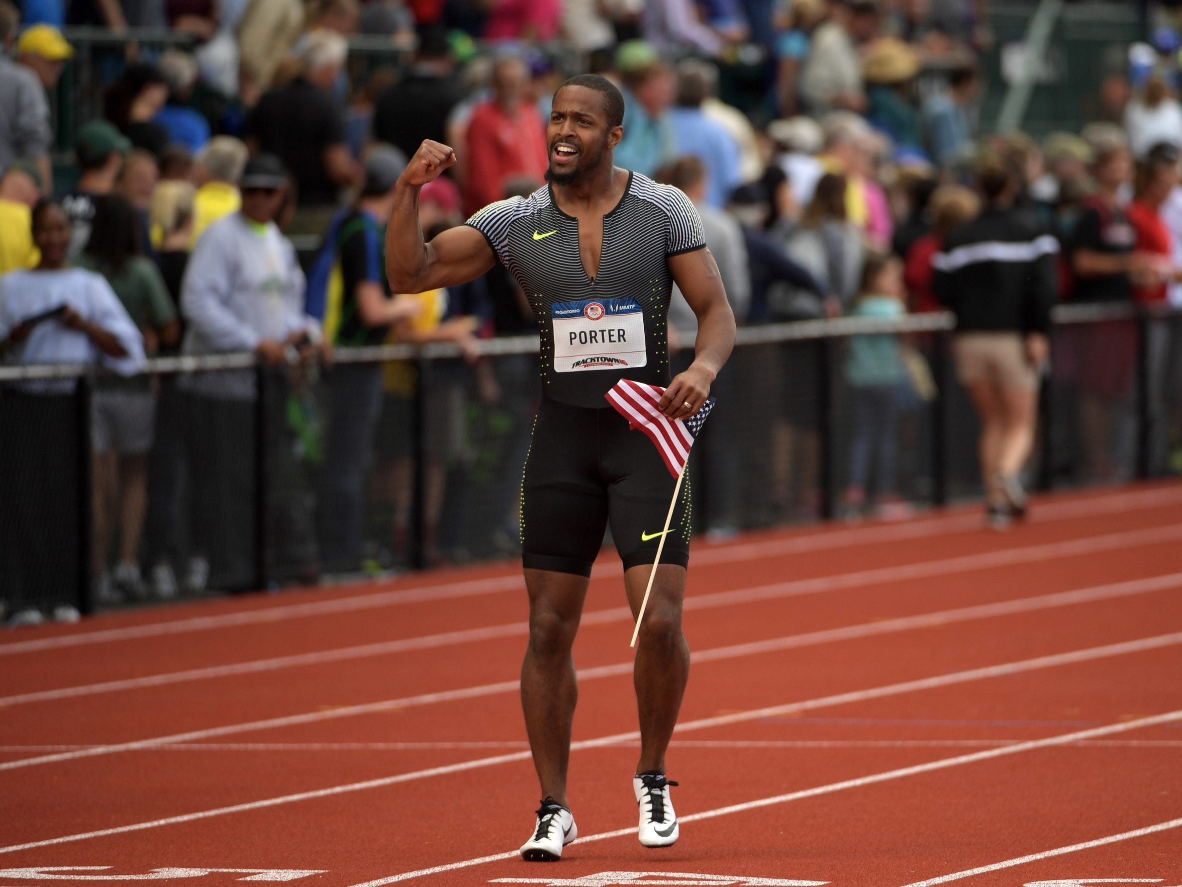Jeff Porter poses with United States flag after placing