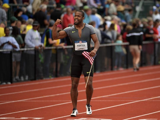 Jeff Porter poses with United States flag after placing third in the 110m hurdles during the 2016 U.S. Olympic Team Trials at Hayward Field.