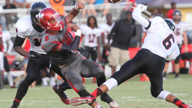 South Fort Myers' Jeshaun Jones forces North Fort Myers' Alfonso Luis during a pre-season game at North Fort Myers High School on Thursday.