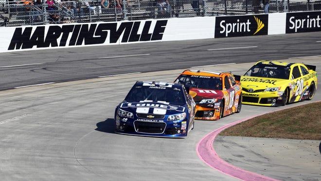 Jimmie Johnson, leads Kyle Busch and Matt Kenseth at Martinsville Speedway.
