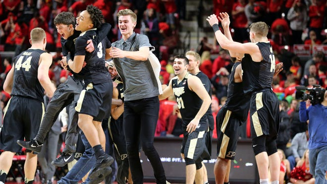 Purdue Boilermakers players celebrate their 73-72 win over the Maryland Terrapins at Xfinity Center.