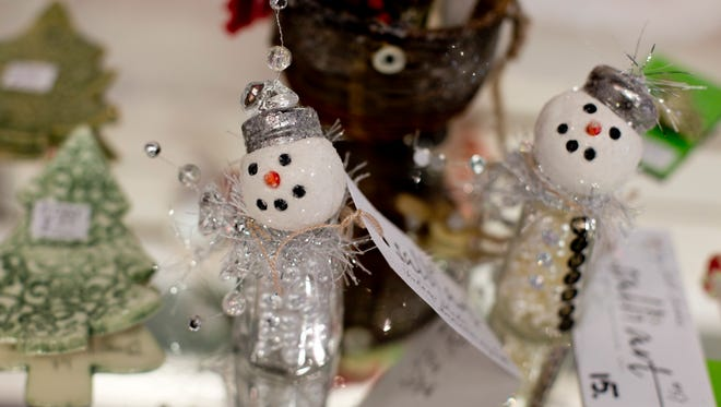 Snowmen figurines by artist Salli Jones are available at the St. Clair Art Association at Riverview Plaza.