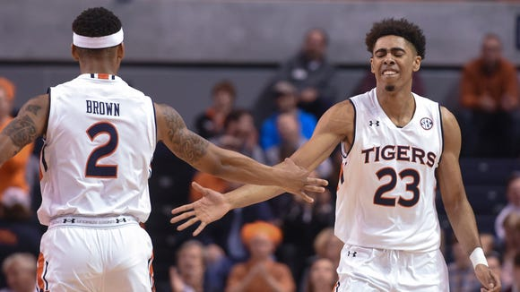 Auburn guard TJ Lang (23) celebrates a 3-point shot against Mississippi State with guard Bryce Brown (2) during an NCAA college basketball game Tuesday, Feb. 7, 2017, in Auburn, Ala.