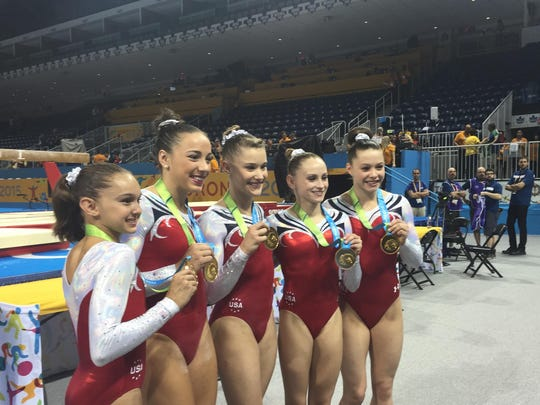 Team USA poses with their gold medals after winning