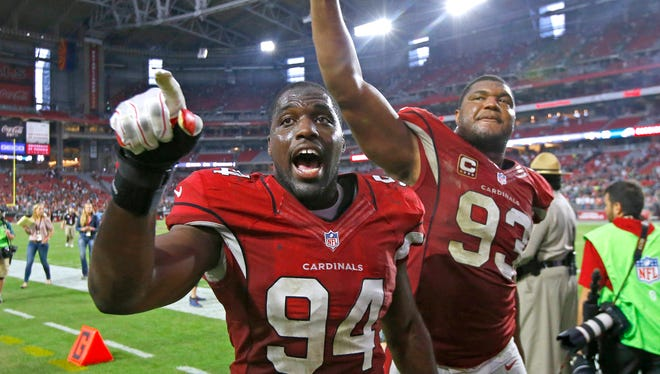 Cardinals outside linebacker Sam Acho (94) and defensive end Calais Campbell (93) celebrate their 24-20 win over the Philadelphia Eagles in their NFL game Sunday, Oct. 26, 2014 in Glendale.