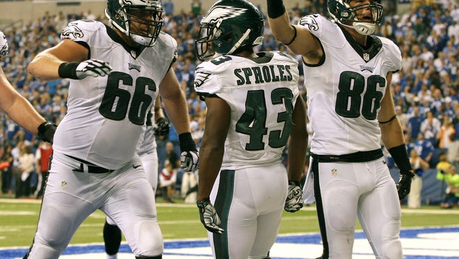 Sep 15, 2014; Indianapolis, IN, USA; Philadelphia Eagles tackle Andrew Gardner (66) and tight end Zach Ertz (86) celebrate the running back Darren Sproles (43) touchdown during the third quarter against the Indianapolis Colts at Lucas Oil Stadium. The Eagles won 30-27.