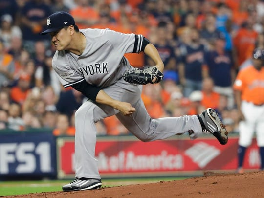 New York Yankees starting pitcher Masahiro Tanaka throws during the first inning of Game 1 of baseball's American League Championship Series against the Houston Astros Friday, Oct. 13, 2017, in Houston.