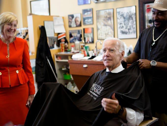 Joe Biden, former Vice President, sits in a barbers